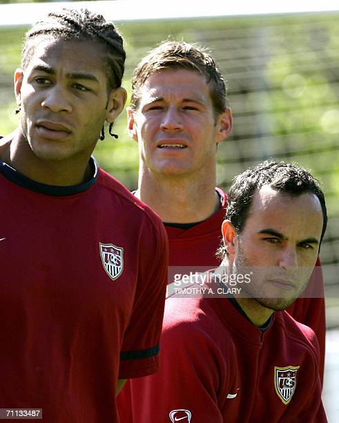 United States midfielder Landon Donovan is flanked by teammates Oguchi Onyewu and Brian McBride during a training session at The Edmund Plambeck...