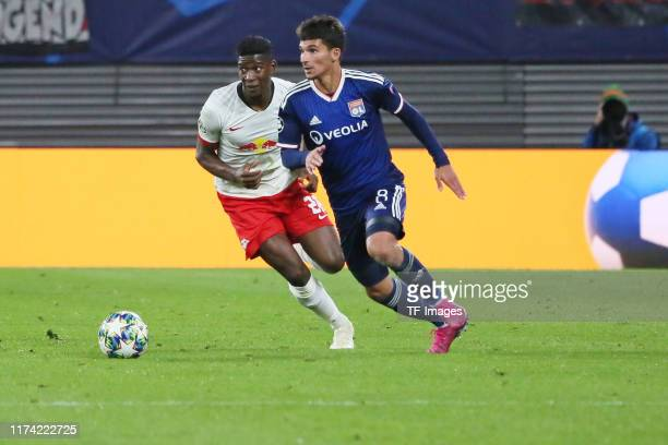 Nordi Mukiele of RB Leipzig and Houssem Aouar of Olympique Lyon battle for the ball during the UEFA Champions League group G match between RB Leipzig...