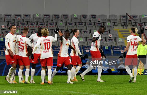 Nordi Mukiele of RB Leipzig celebrates after scoring their sides second goal with team mates during the UEFA Champions League Group H stage match...
