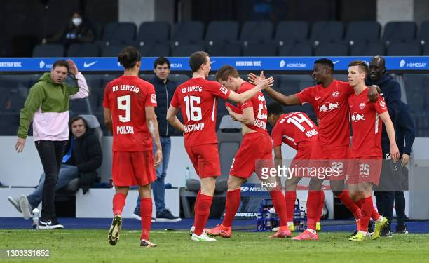 Nordi Mukiele of RB Leipzig celebrates with Yussuf Poulsen, Lukas Klostermann, Marcel Halstenberg, Tyler Adams and Dani Olmo after scoring his team's...
