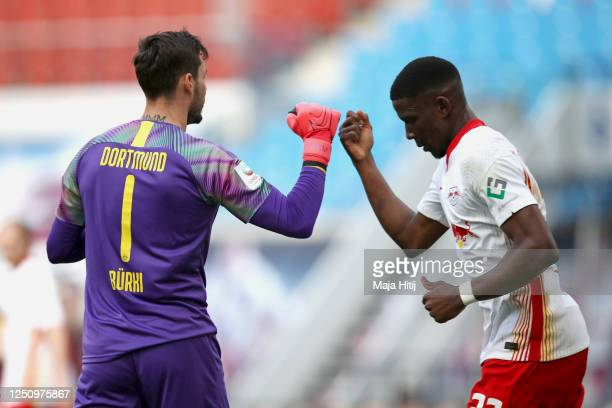 Nordi Mukiele of RB Leipzig congratulates Roman Buerki of Borussia Dortmund after saving the ball during the Bundesliga match between RB Leipzig and...