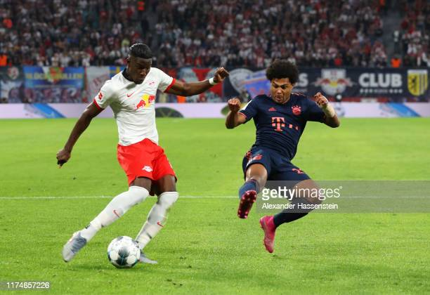 Nordi Mukiele of RB Leipzig is challenged by Serge Gnabry of FC Bayern Munich during the Bundesliga match between RB Leipzig and FC Bayern Muenchen...
