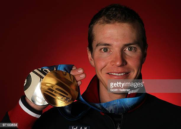 Nordic combined skier Bill Demong of the United States poses with his gold medal for the crosscountry individual LH/10 km and silver medal for the...