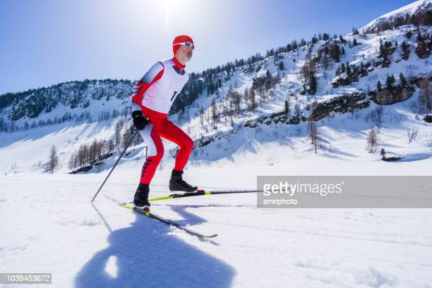 nordic cross country skier in winter mountains - winter sports event stock pictures, royalty-free photos & images