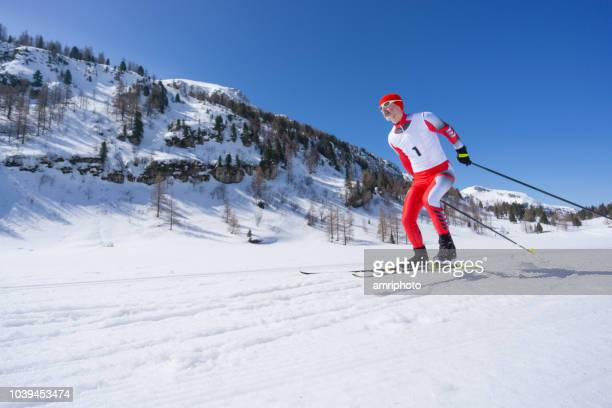 nordic cross country skier skating on snow sport track in mountains - winter sports event stock pictures, royalty-free photos & images