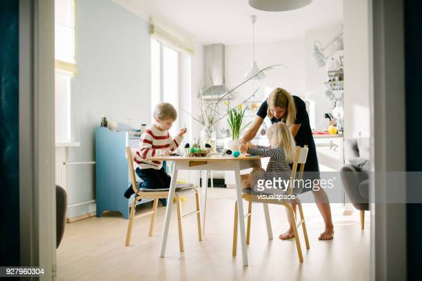 nordic family during an easter preparation - happy easter mom stock pictures, royalty-free photos & images