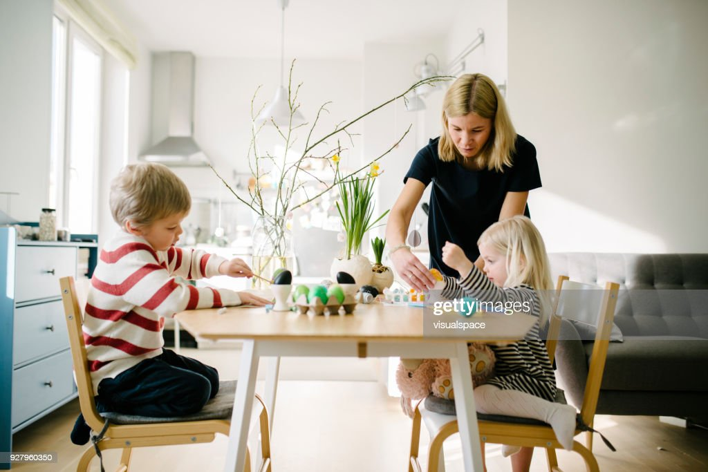 Nordic family during an Easter preparation : Stock Photo