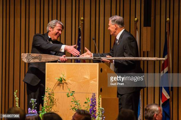 Nordic Museum Executive Director Eric Nelson accepts a gift from Washington Governor Jay Inslee at the Nordic Museum on May 4 2018 in Seattle...