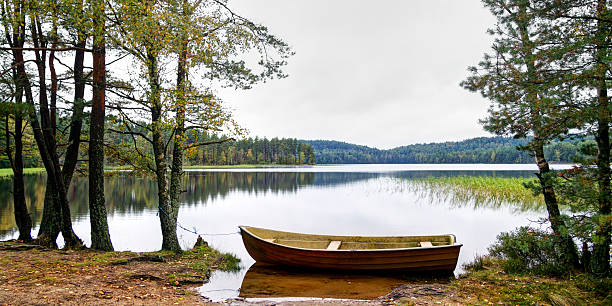 Nordic skiff (eka) moored by a quiet lake
