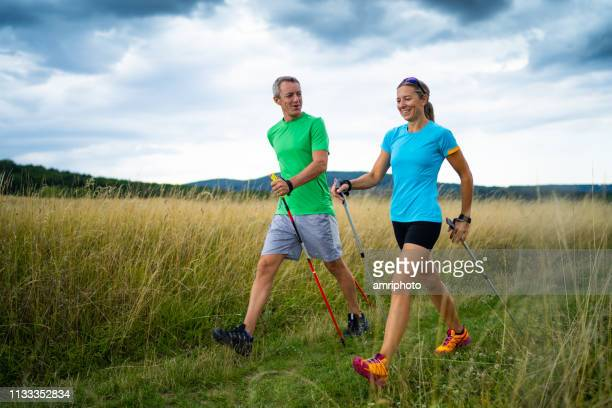 nordic walking couple in grassland