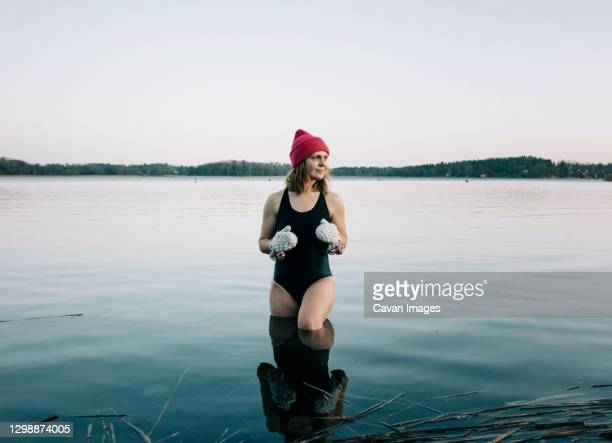 nordic woman stood on the baltic sea ready for cold water swimming - cold temperature stock pictures, royalty-free photos & images