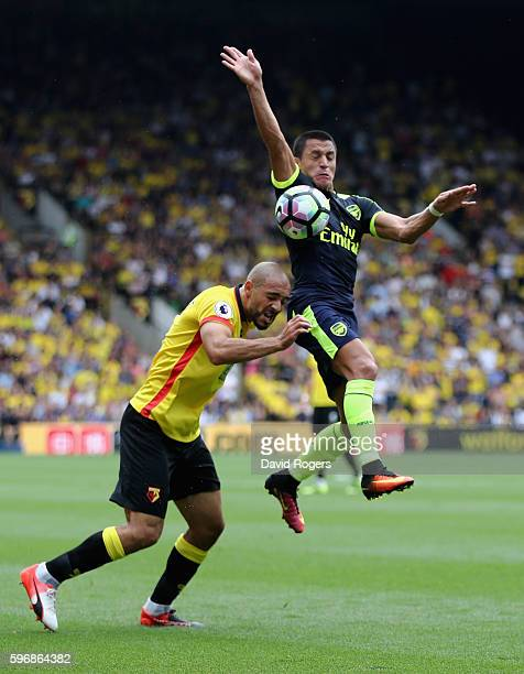 Nordiln Amrabat of Watford is challenged by Alexis Sanchez during the Premier League match between Watford and Arsenal at Vicarage Road on August 27...