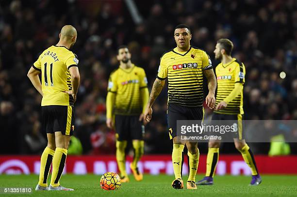 Nordin Amrabat and Troy Deeney of Watford stand dejected after conceding the opening goal during the Barclays Premier League match between Manchester...