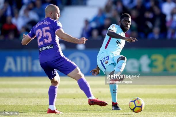 Nordin Amrabat of Leganes Samuel Umtiti of FC Barcelona during the Spanish Primera Division match between Leganes v FC Barcelona at the Estadio...