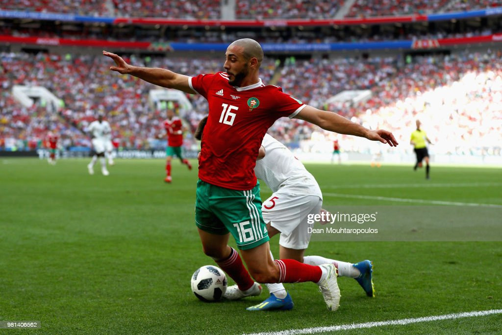 Nordin Amrabat of Morocco gets tackled by Raphael Guerreiro of Portugal during the 2018 FIFA World Cup Russia group B match between Portugal and Morocco at Luzhniki Stadium on June 20, 2018 in Moscow, Russia.