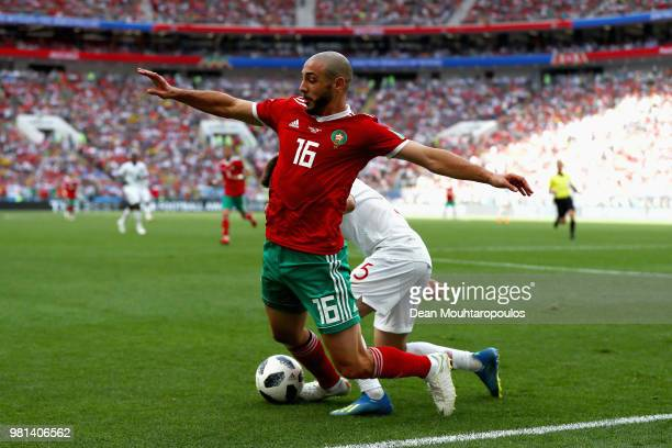 Nordin Amrabat of Morocco gets tackled by Raphael Guerreiro of Portugal during the 2018 FIFA World Cup Russia group B match between Portugal and...