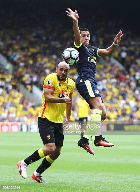 Nordin Amrabat of Watford and Alexis Sanchez of Arsenal battle for possession in the air during the Premier League match between Watford and Arsenal...