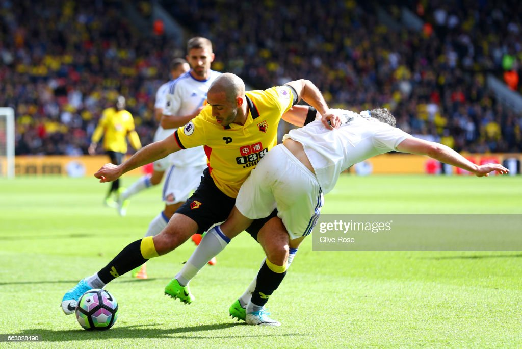 Nordin Amrabat of Watford (L) and Bryan Oviedo of Sunderland (R) battle for possession during the Premier League match between Watford and Sunderland at Vicarage Road on April 1, 2017 in Watford, England.