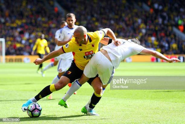 Nordin Amrabat of Watford and Bryan Oviedo of Sunderland battle for possession during the Premier League match between Watford and Sunderland at...