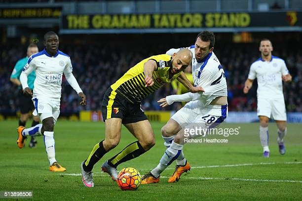 Nordin Amrabat of Watford and Christian Fuchs of Leicester City compete for the ball during the Barclays Premier League match between Watford and...