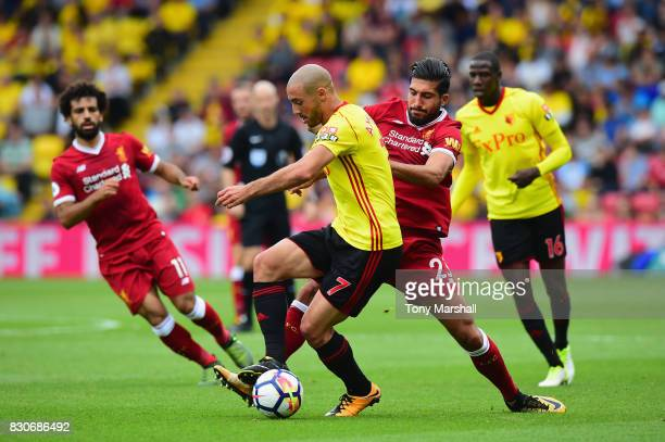 Nordin Amrabat of Watford and Emre Can of Liverpool battle for possession during the Premier League match between Watford and Liverpool at Vicarage...