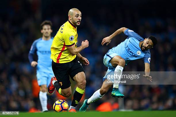 Nordin Amrabat of Watford and Gael Clichy of Manchester City battle for possession during the Premier League match between Manchester City and...