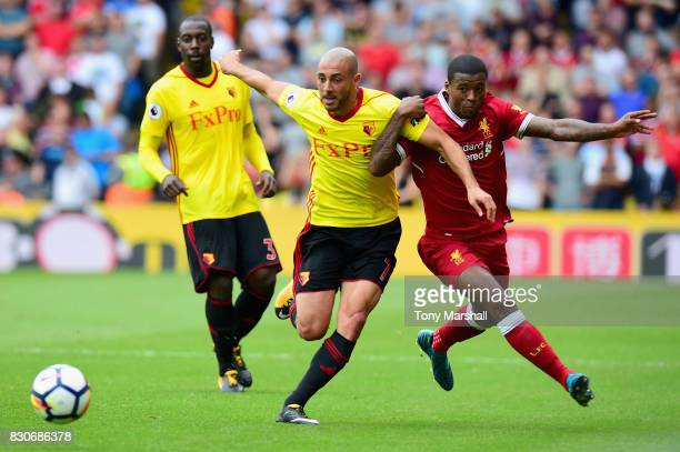 Nordin Amrabat of Watford and Georginio Wijnaldum of Liverpool battle for possession during the Premier League match between Watford and Liverpool at...