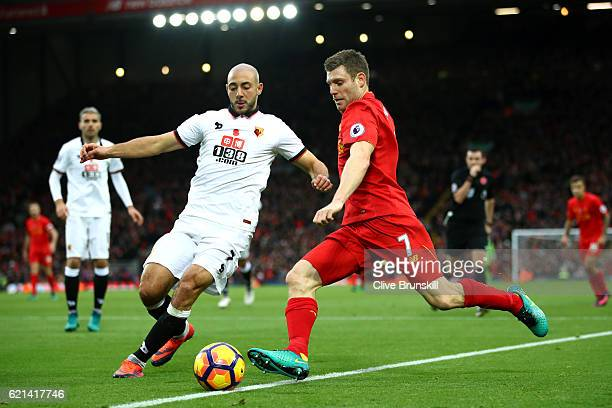 Nordin Amrabat of Watford and James Milner of Liverpool in action during the Premier League match between Liverpool and Watford at Anfield on...