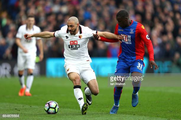 Nordin Amrabat of Watford and Jeffrey Schlupp of Crystal Palace battle for possession during the Premier League match between Crystal Palace and...