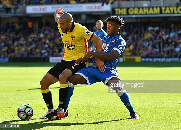 Nordin Amrabat of Watford and Jordan Ibe of AFC Bournemouth battle for possession during the Premier League match between Watford and AFC Bournemouth...