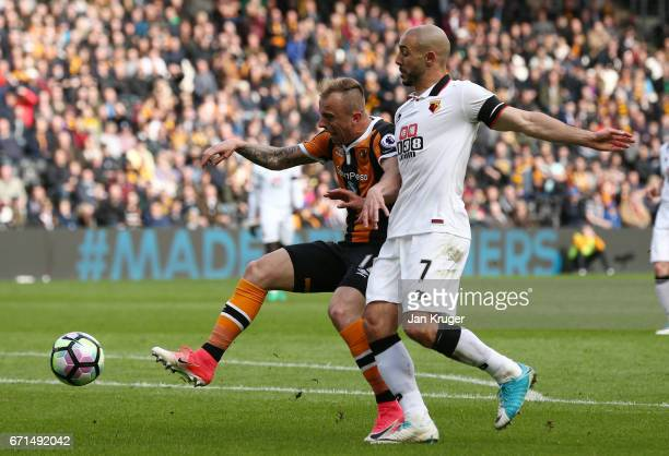Nordin Amrabat of Watford and Kamil Grosicki of Hull City clash inside the box during the Premier League match between Hull City and Watford at the...