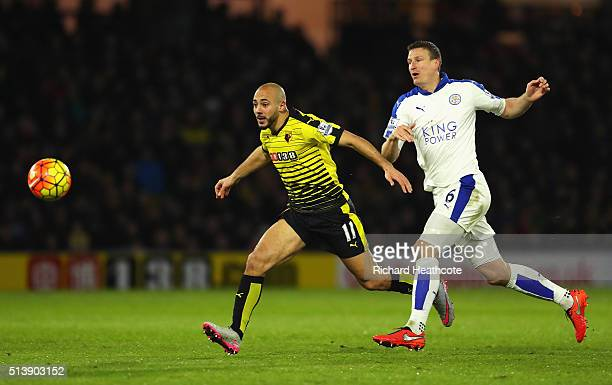 Nordin Amrabat of Watford and Robert Huth of Leicester City compete for the ball during the Barclays Premier League match between Watford and...