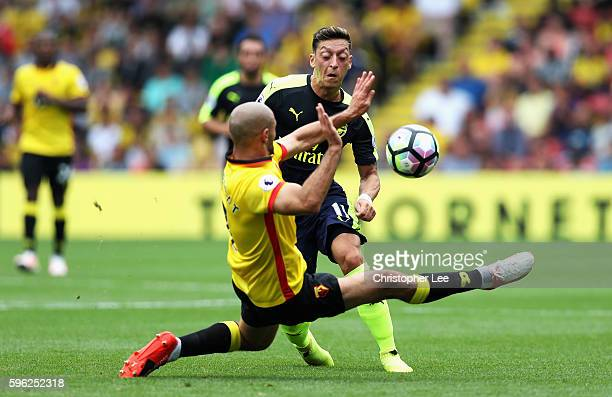 Nordin Amrabat of Watford attempts to black Mesut Ozil of Arsenal pass during the Premier League match between Watford and Arsenal at Vicarage Road...