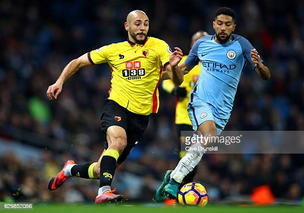 Nordin Amrabat of Watford attempts to take the ball past Gael Clichy of Manchester City during the Premier League match between Manchester City and...