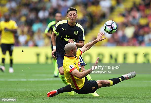 Nordin Amrabat of Watford blocks Mesut Ozil of Arsenal shot during the Premier League match between Watford and Arsenal at Vicarage Road on August 27...
