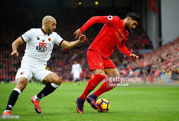 Nordin Amrabat of Watford closes down Emre Can of Liverpool during the Premier League match between Liverpool and Watford at Anfield on November 6...