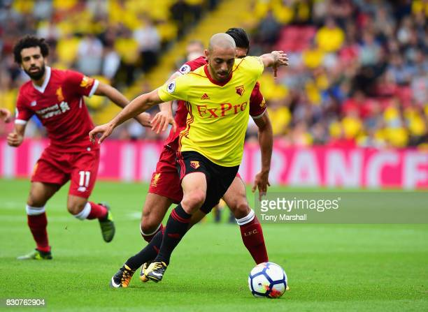 Nordin Amrabat of Watford holds off a challenge from Emre Can of Liverpool during the Premier League match between Watford and Liverpool at Vicarage...