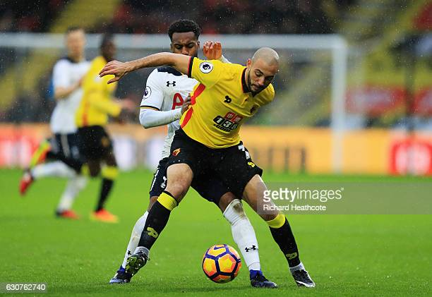 Nordin Amrabat of Watford holds off Danny Rose of Tottenham Hotspur during the Premier League match between Watford and Tottenham Hotspur at Vicarage...