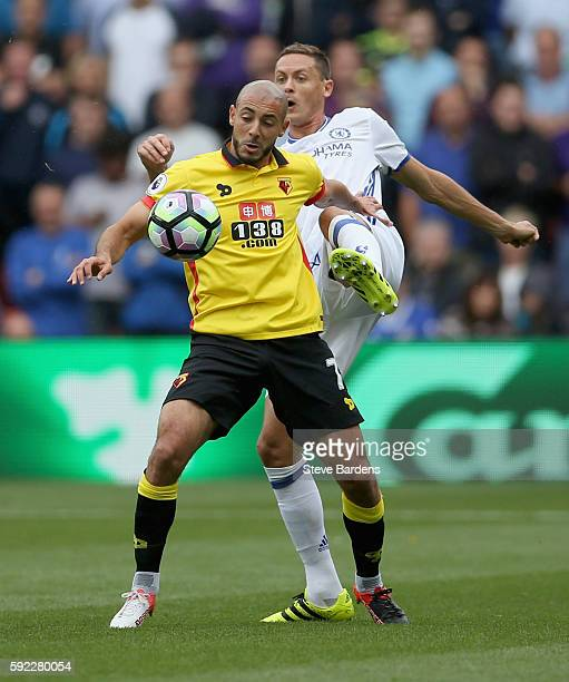 Nordin Amrabat of Watford holds off Nemanja Matic of Chelsea during the Premier League match between Watford and Chelsea at Vicarage Road on August...