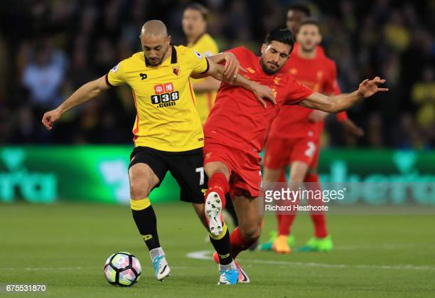 Nordin Amrabat of Watford holds off the challenge from Emre Can of Liverpool during the Premier League match between Watford and Liverpool at...