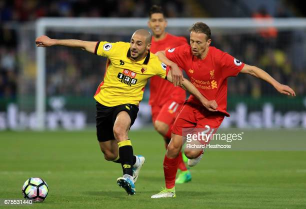 Nordin Amrabat of Watford holds off the challenge from Lucas Leiva of Liverpool during the Premier League match between Watford and Liverpool at...