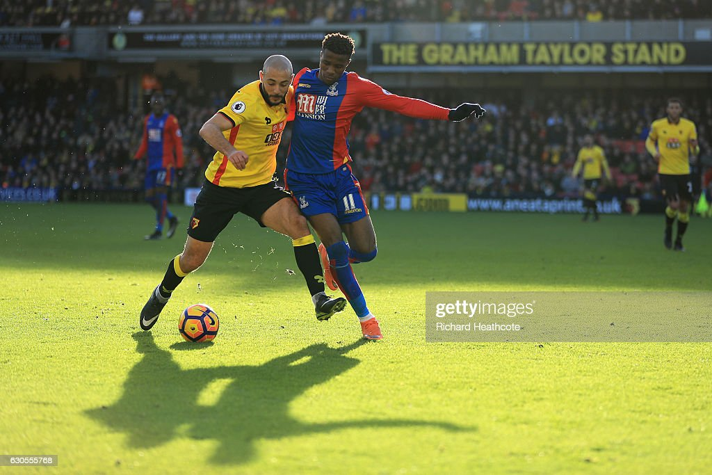 Nordin Amrabat of Watford holds off Wilfred Zaha of Palace during the Premier League match between Watford and Crystal Palace at Vicarage Road on December 26, 2016 in Watford, England.