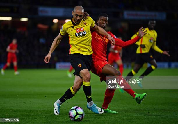 Nordin Amrabat of Watford is challenged by Georginio Wijnaldum of Liverpool during the Premier League match between Watford and Liverpool at Vicarage...