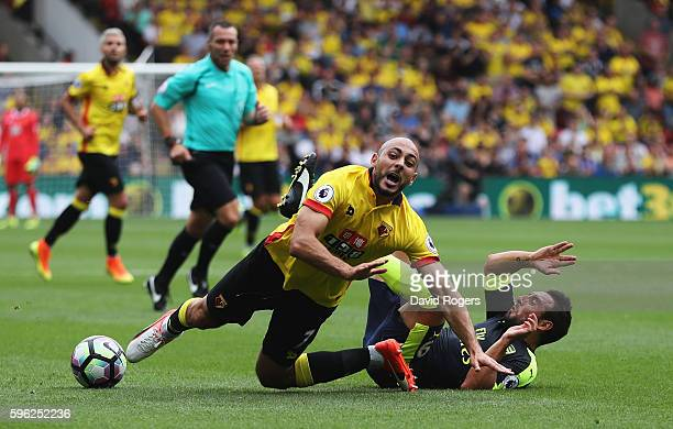 Nordin Amrabat of Watford is challenged by Santi Cazorla of Arsenal during the Premier League match between Watford and Arsenal at Vicarage Road on...