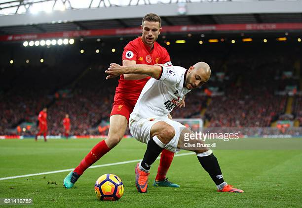 Nordin Amrabat of Watford is closed down by Jordan Henderson of Liverpool during the Premier League match between Liverpool and Watford at Anfield on...