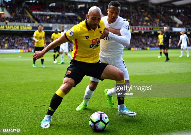 Nordin Amrabat of Watford is put under pressure from Martin Olsson of Swansea City during the Premier League match between Watford and Swansea City...