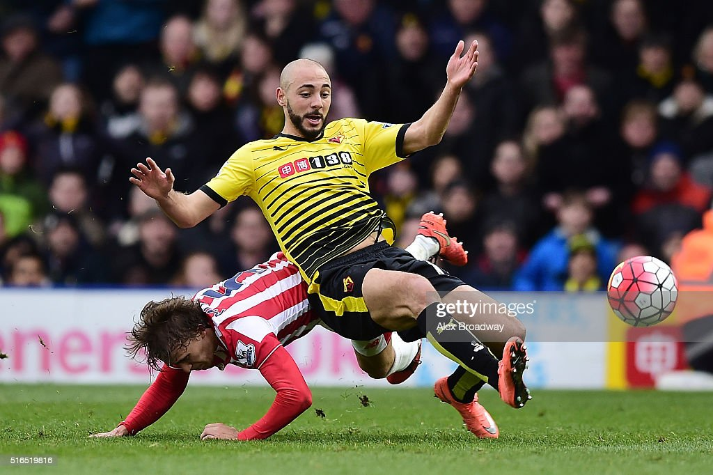 Nordin Amrabat of Watford is tackled by Marc Muniesa of Stoke City during the Barclays Premier League match between Watford and Stoke City at Vicarage Road on March 19, 2016 in Watford, United Kingdom.