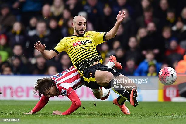 Nordin Amrabat of Watford is tackled by Marc Muniesa of Stoke City during the Barclays Premier League match between Watford and Stoke City at...