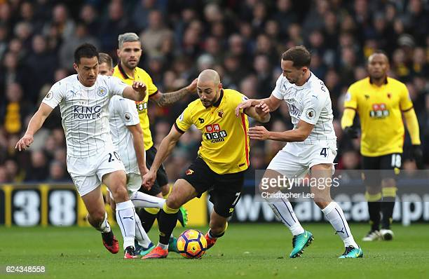Nordin Amrabat of Watford is tackled by Shinji Okazaki of Leicester City and Daniel Drinkwater of Leicester City during the Premier League match...