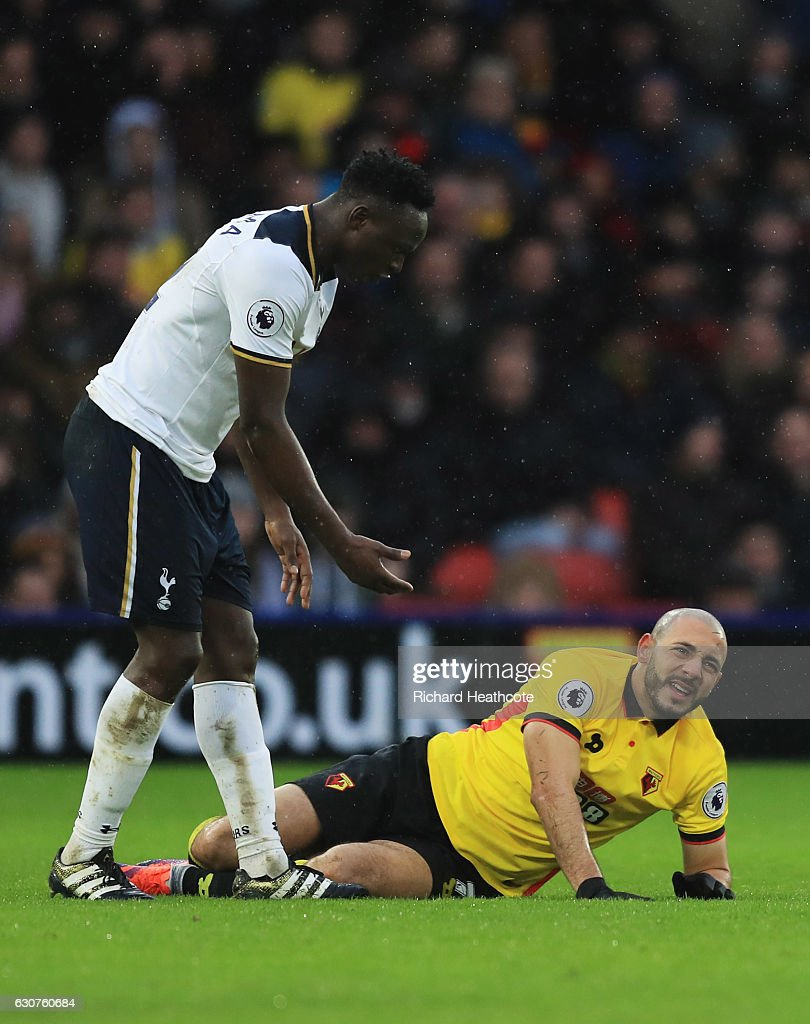 Nordin Amrabat of Watford reacts as he is injured alongside Victor Wanyama of Tottenham Hotspur during the Premier League match between Watford and Tottenham Hotspur at Vicarage Road on January 1, 2017 in Watford, England.